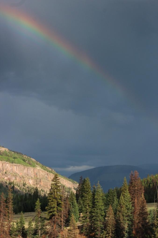 rainbow and heavy sky