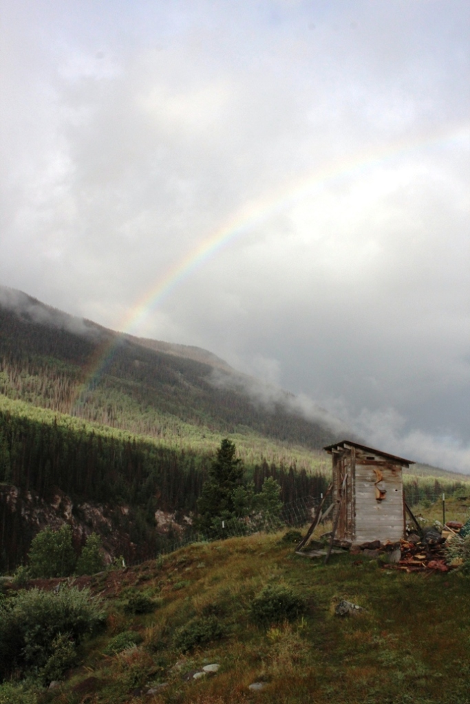 rainbow over outhouse